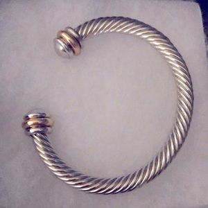Sophistication is this Two-Tone cable bracelet